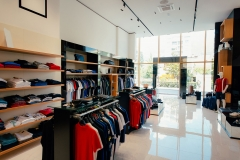 Interior of a clothing store. Clothing for men and women on the